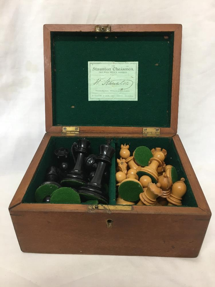 Lot 28 - A Jaque London wooden chess set with led weighted bottoms. (full set) all housed in a box barked Sta