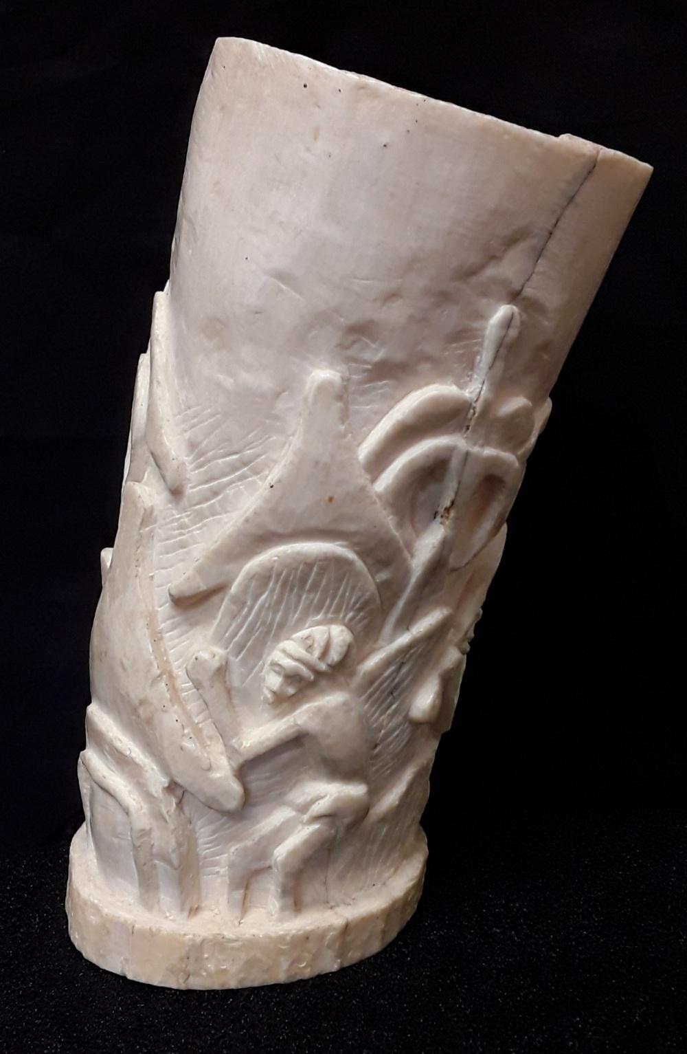 Lot 7 - A heavily carved ivory vase/tall brush pot.
