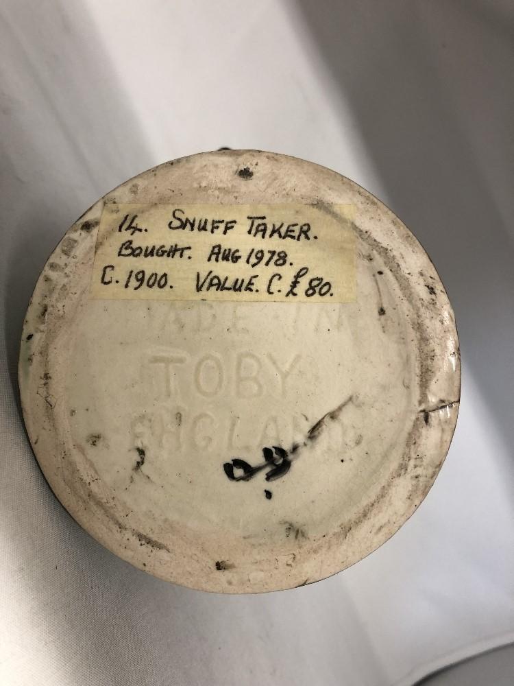 Lot 44 - The Snuff Taker toby jug (circa 1900).