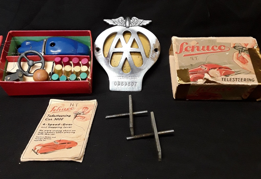 """Lot 5 - A Schuco Telesteering Car 3000 with instructions and box together with an AA car badge """"OD69807""""."""