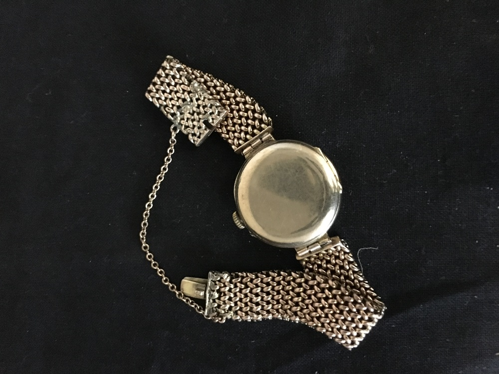 Lot 58 - A 9ct gold lady's wristwatch.