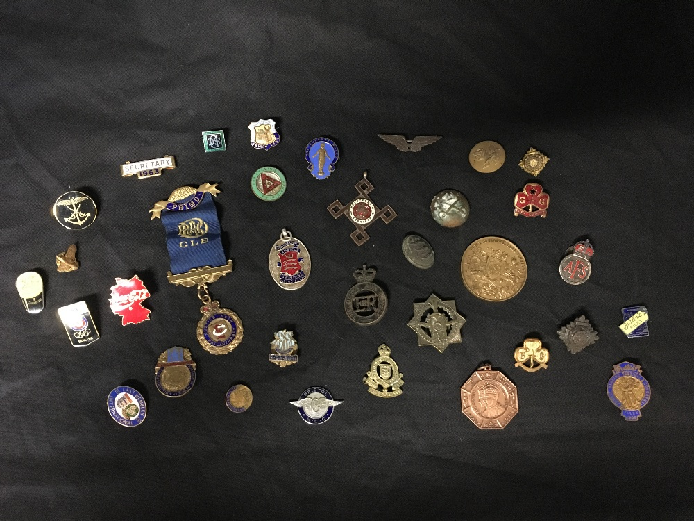 Lot 46 - A large collection of military and enamel badges including Butlins, Bristol Motorcycle Club etc.