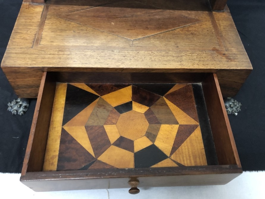 Lot 29 - An Art Deco vanity mirror with marquetry inlay to the inside of the drawer.
