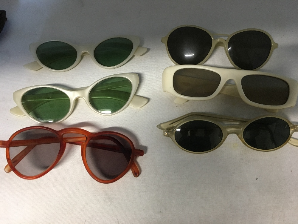 """Lot 14 - 14 pairs of vintage lady's sunglasses including """"Cutler and Gross"""" of London and Kenzo."""