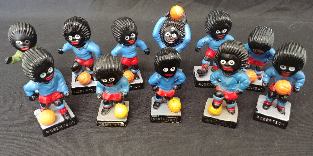 Lot 23 - A set of 11 Robinson's Gollie football players.