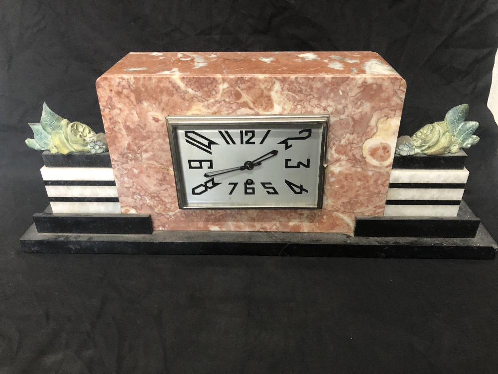 Lot 3 - An Art Deco mantel clock with key.