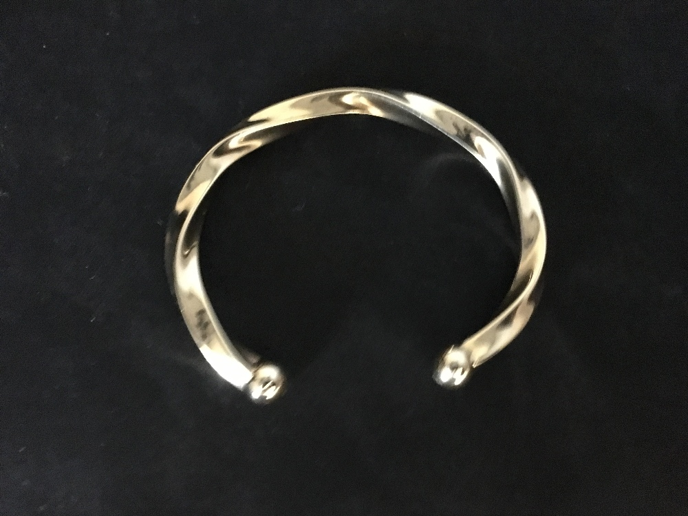 Lot 49 - A 9ct gold twisted bangle.