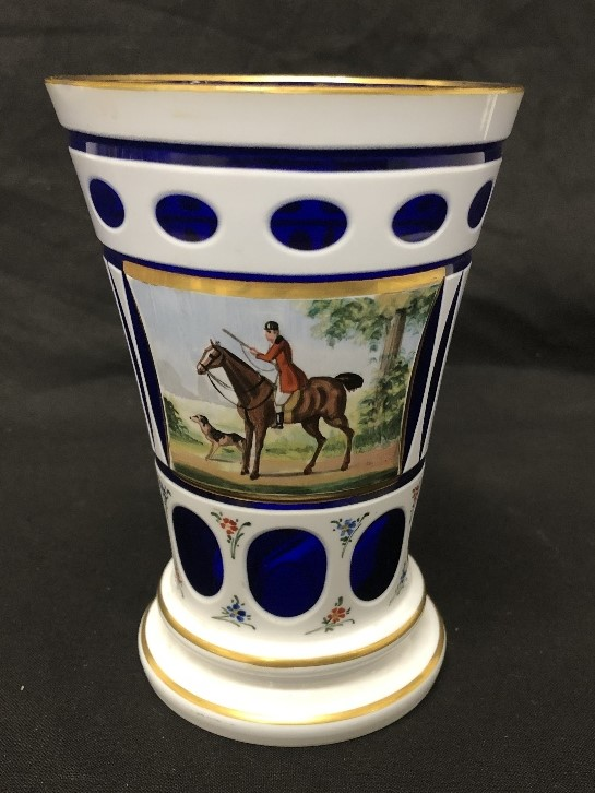 Lot 30 - A 19th Century overlaid glass beaker/vase with a hand painted panel depicting a horse and rider.
