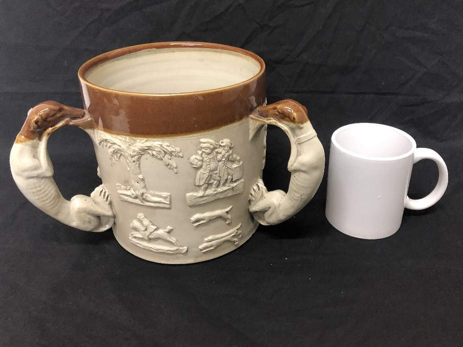 Lot 22 - A Brampton Pottery tavern mug circa 1840 with handles modelled as greyhounds