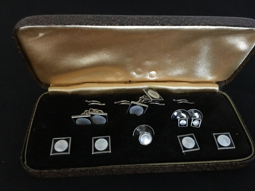 Lot 59 - A set of white metal and mother of pearl gent's cufflinks and tiepin. In original box.