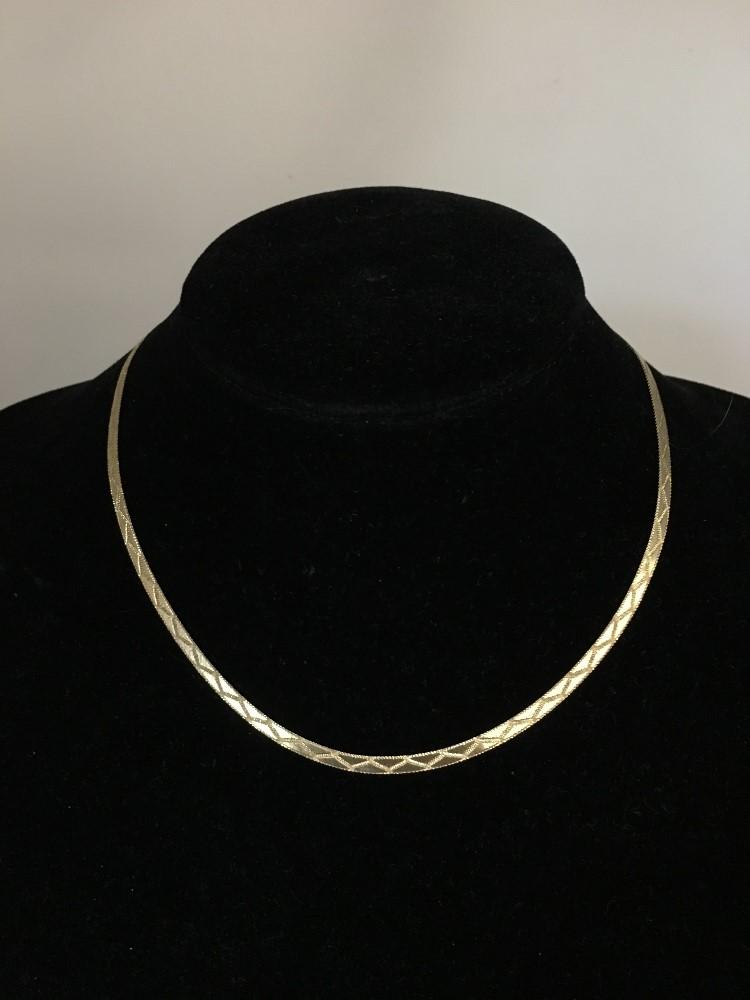 Lot 53 - A 9ct gold necklace in herringbone links.