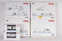 Märklin, zehn Güterwagen (vier Sets und zwei Einzelwagen)Märklin, zehn Güterwagen (vier Sets und