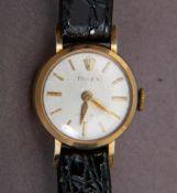ROLEX - Frühe Damenarmbanduhr. 585er Gelbgoldgehäuse an ergänzten Lederarmband, wohl 1950er Jahre.