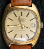 BIFORA AUTOMATIK Herrenarmbanduhr der 1960er/70er Jahre. Zentrale Sekunde & Datumsanzeige, 585er