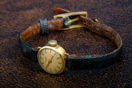 "585er Gelbgold ""DUGENA""-Damenarmbanduhr, Handaufzug, Mitte 20. Jhd., Werk ungeprüft, an getragenem"