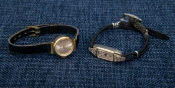 2 x 585er Damenarmbanduhr, beide defekt/ungeprüft, 1 x Weißgold mit Diamantbesatz & 1 x Gelbgold.- -