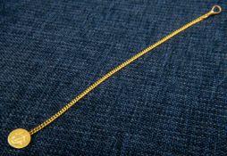 """Taschenuhrenkette, 585er Gelbgold, Länge ca. 23 cm, ca. 8 gr., Abschlussplättchen mit Monogramm """""""