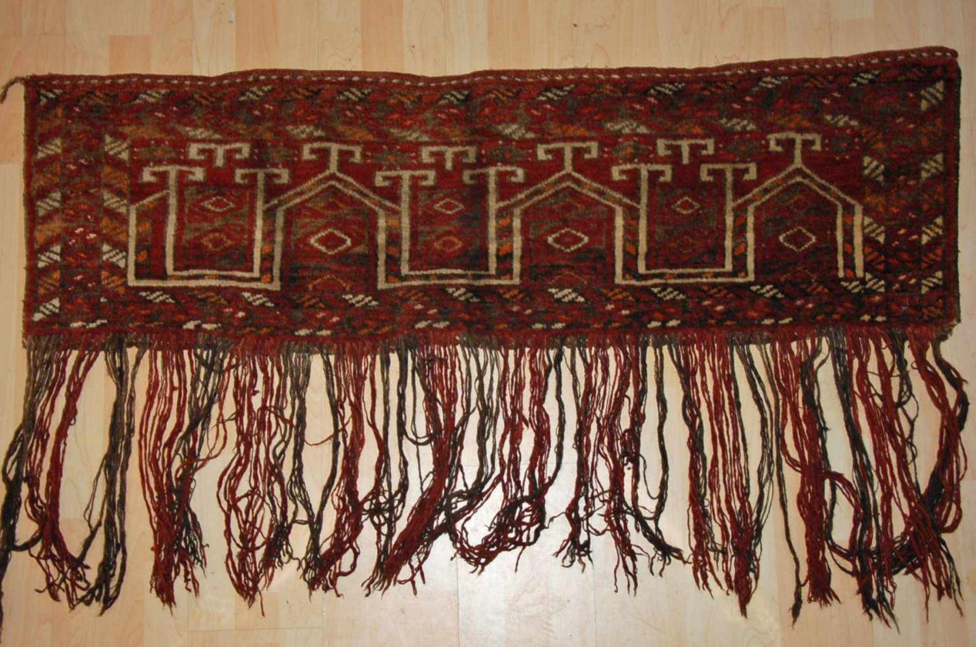 Torba, Afghanistanlange Fransen, ca. 139 x 38 cm.
