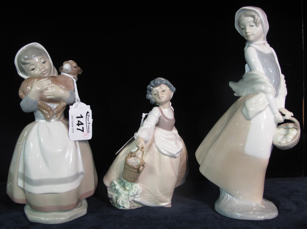 Lot 147 - Three Nao Spanish porcelain figurines with goat and basket of flowers. (3) (B.P. 24% incl.