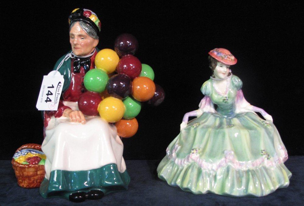 Lot 144 - Royal Doulton bone china figurine 'The Old Balloon Seller' HN135,