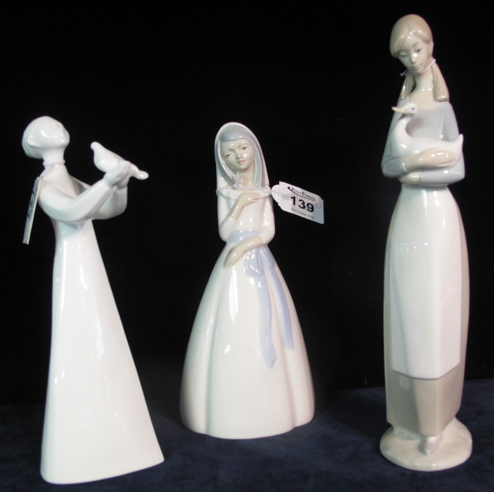 Lot 139 - Royal Doulton bone china figurine 'Peace' HN2470, together with two Spanish porcelain figurines,