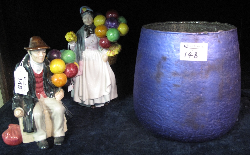 Lot 148 - Two 'The Leonardo Collection' fine porcelain figurines of 'The Balloon lady' and 'The Balloon man'.