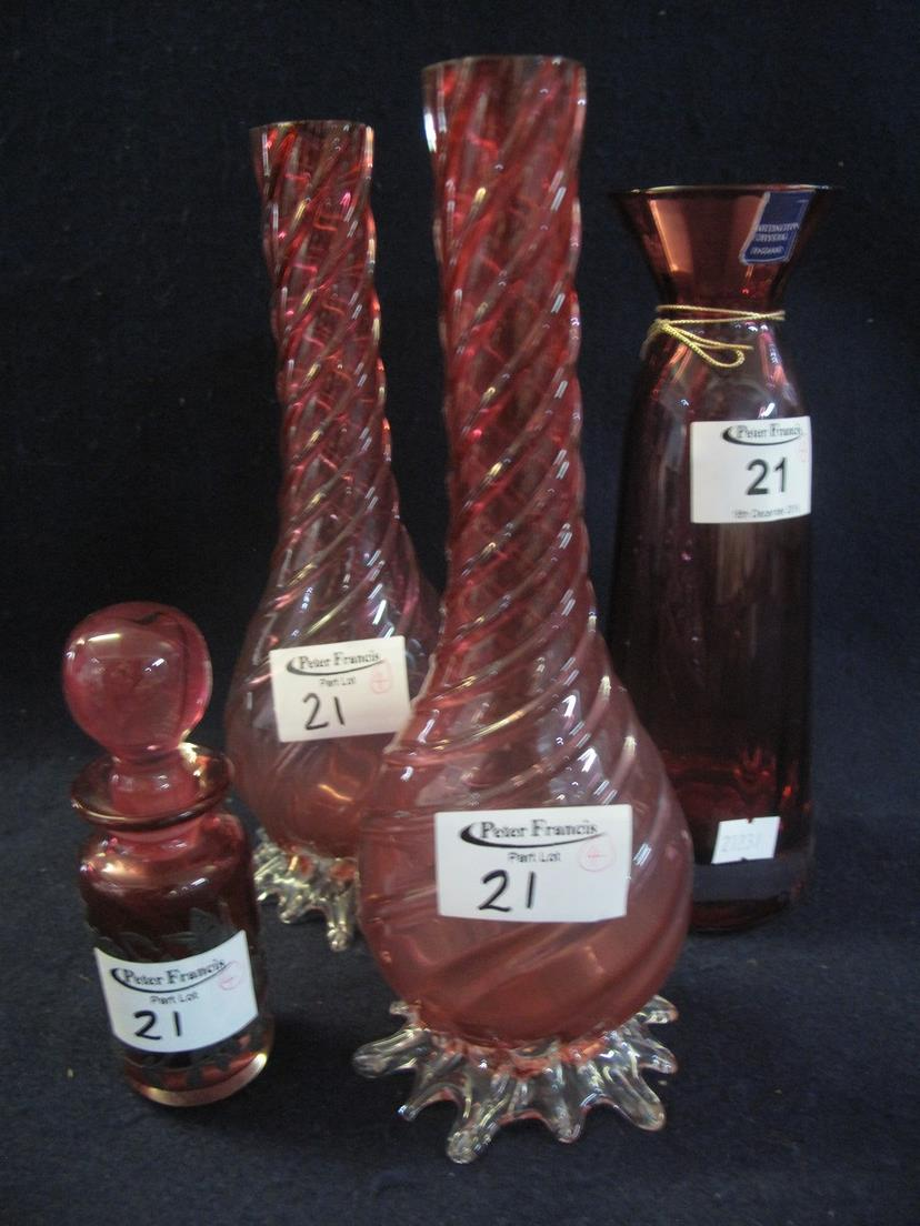 Lot 21 - Collection of cranberry glass to include; pair of swirl decorated vases,