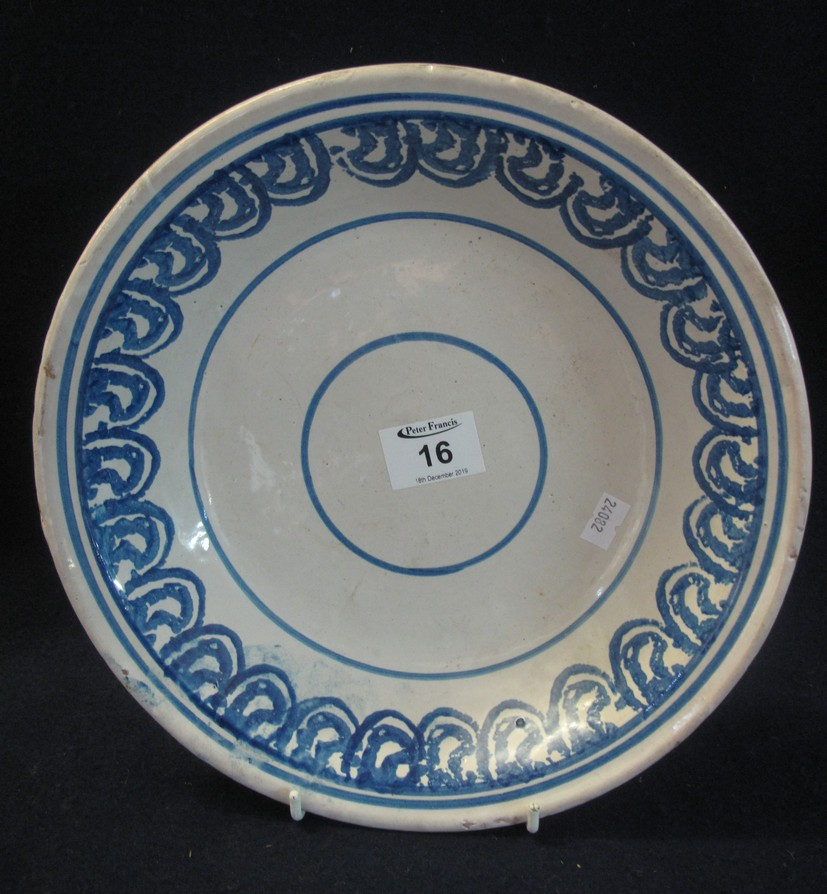 Lot 16 - 19th Century tin glazed blue and white painted shallow bowl. Unmarked, probably continental. (B.P.
