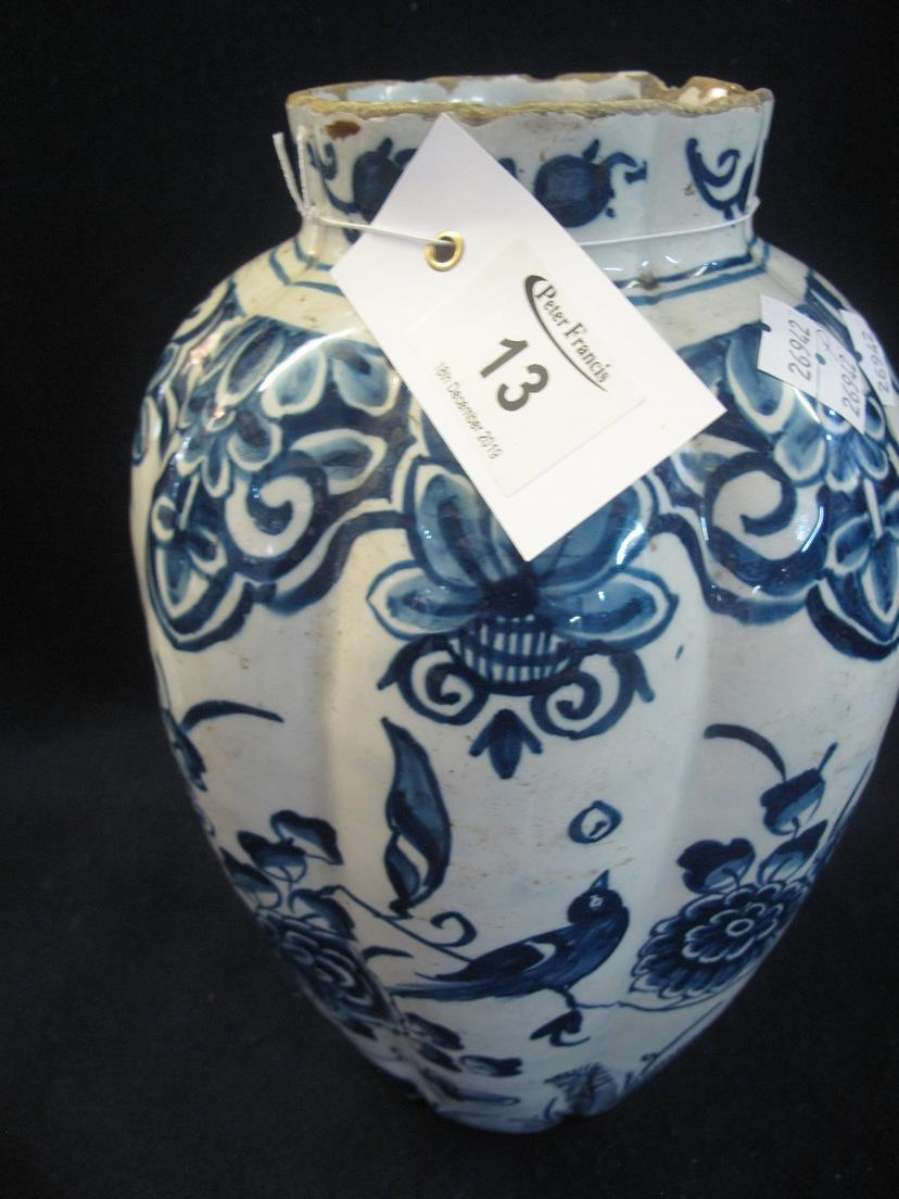 Lot 13 - 18th/19th Century Dutch Delft tin glazed earthenware vase of fluted form, overall with peacocks,