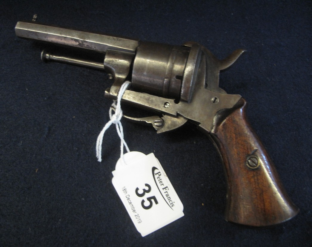 Lot 35 - Late 19th Century pin fire revolver having wooden grips and integral ramrod.