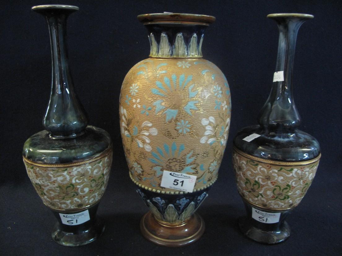 Lot 51 - Pair of Doulton Lambeth vases with foliate decoration,
