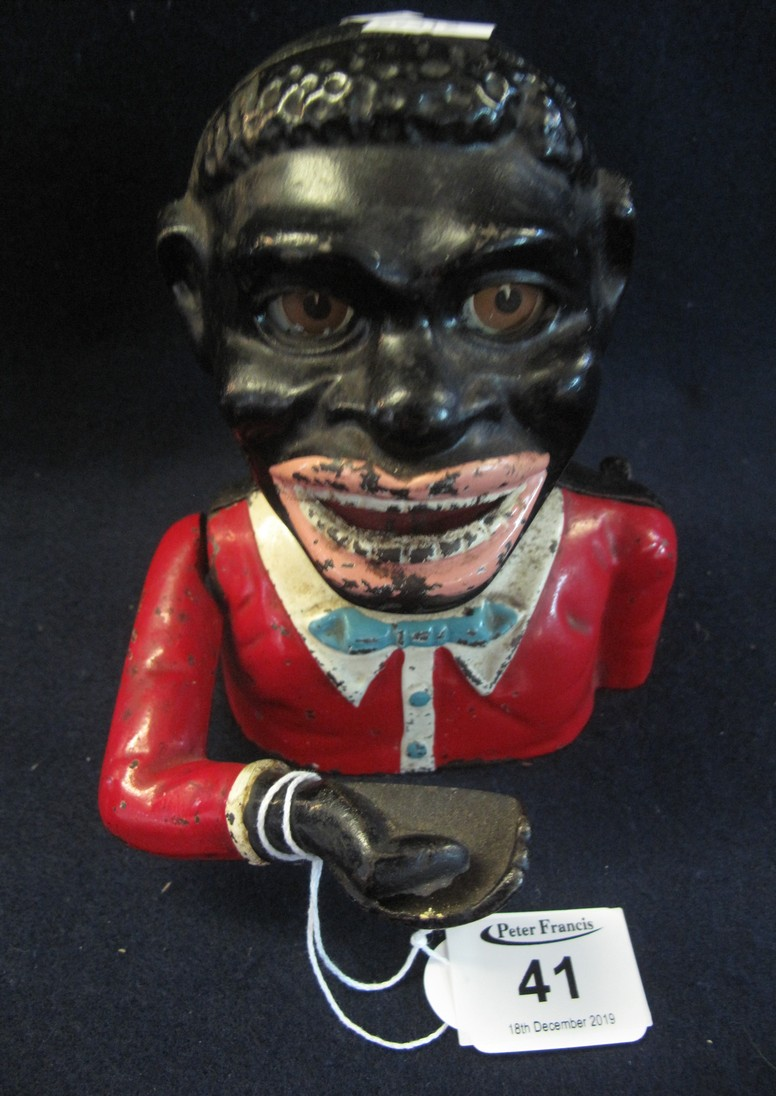 Lot 41 - Cast metal black man money box. (B.P. 24% incl.
