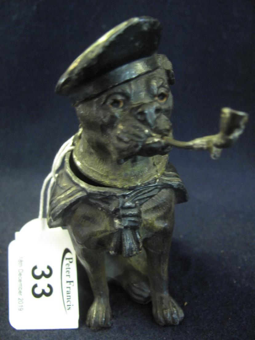 Lot 33 - Novelty white metal inkwell in the form of a seated boxer dog smoking a pipe and wearing a navel