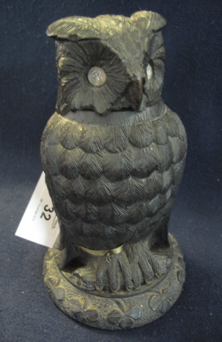 Lot 32 - Unusual stained and carved desk inkwell in the form of a seated owl with shamrock decoration. (B.P.