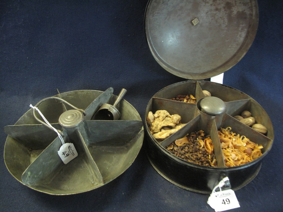 Lot 49 - Georgian tin spice box of circular form with six piece segmented interior and grater.