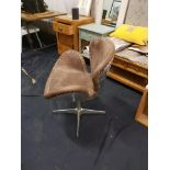 Lot 44 - Reno Swivel Armchair Mocha Leather And Steel Add A Touch Of Equestrian Style To A Room With This