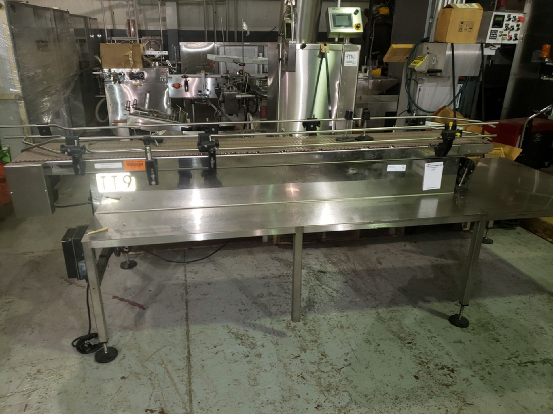 """Lot 18 - McKenzie Surge slat conveyor, 2x 6""""W x 96""""L, mounted on a s/s tabletop, 110 volts"""