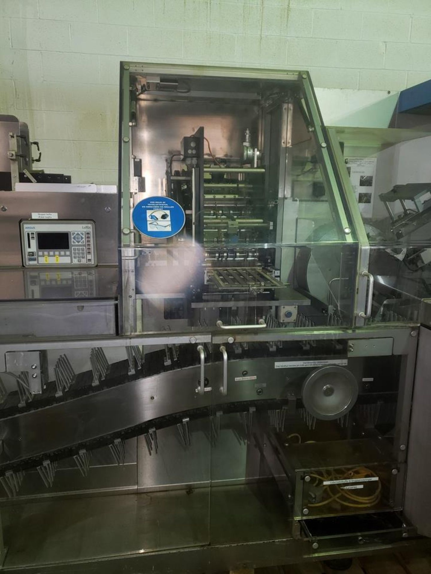 Lot 15 - Uhlmann Model C2205 Automatic Horizontal Tuck Cartoner. Machine is capable of speeds up to 250