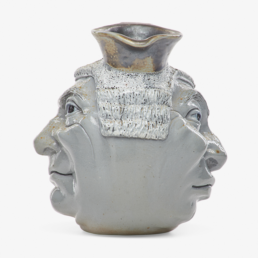 Lot 11 - ROBERT W. MARTIN; MARTIN BROTHERS BARRISTER DOUBLE-SIDED FACE JUG