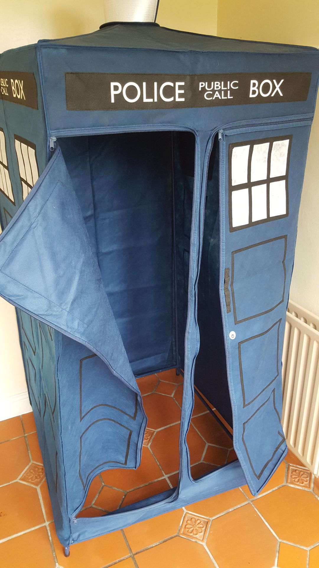 Lot 1304 - Dr Who Fabric Wardrobe on Steel Frame approx 800mm square.