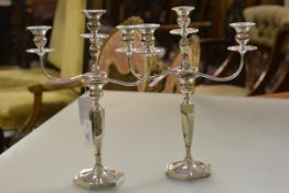 A pair of George V silver three-light candelabra, George Edwards & Sons, Sheffield 1910, each