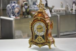 A Louis XV style gilt-metal mounted marquetry bracket clock, 20th century of cartouche shape, the