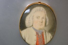 English School, c. 1760, a portrait miniature of a bewigged gentleman in a red waistcoat,