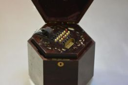 A rosewood forty-eight button concertina by Lachenal & Co., London, with fret-carved hexagonal ends,