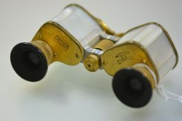 A pair of German mid-20th century mother-of-pearl mounted gilt-metal opera glasses, uncased.