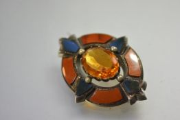 A late 19th century Scottish citrine and specimen hardstone brooch, centred by an oval-cut citrine