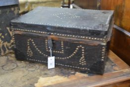 An 18th century brass-studded leather flat-top box, with decorative studwork to top and front,