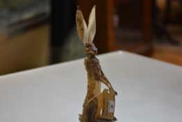 Jeremy James (Contemporary), Medium Hare, a ceramic model with glass eyes, incised signature to