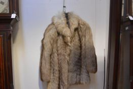 A 1970's short coyote fur coat, with leather trimmed pockets, bearing size label 42.