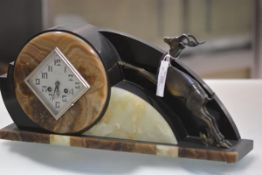 A Continental marble and patinated metal mantel clock in the Art Deco taste, the lozenge dial with
